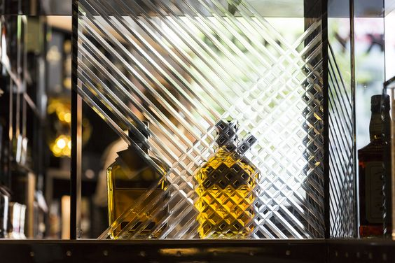 joinery detail - etched glass backpanles   textured glass   The Whisky Shop in Manchester