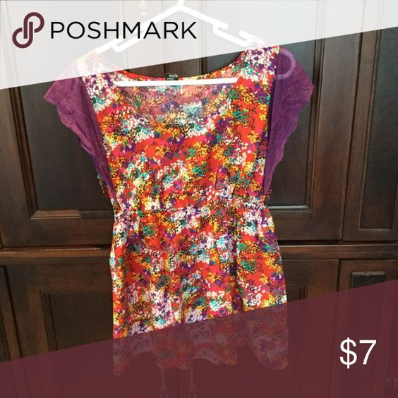 Top with lace sleeves. Multicolored top has lace flutter sleeves. One plastic loop for hanging missing, otherwise in great condition. Worn once or twice. Hello Miss Tops Blouses