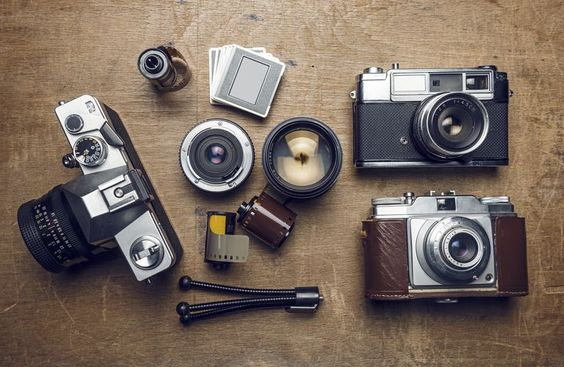 photographic equipment, cameras, slides, lenses, rolls of film