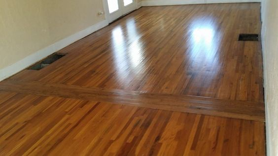 Replace bad patch in wood floors from old walls w/ opposite direction planks! Genius.