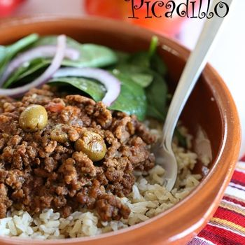 Crock Pot Picadillo   2 1/2 lbs 93% lean ground beef  1 cup minced onion  1 cup diced red bell peppers  3 cloves garlic, minced  1/4 cup minced cilantro  1 small tomato, diced  8 oz can tomato sauce  1/4 cup alcaparrado (manzanilla olives, pimientos, capers) or green olives  1 1/2 tsp ground cumin  1/4 tsp garlic powder  2 bay leaves  kosher salt and fresh pepper, to taste