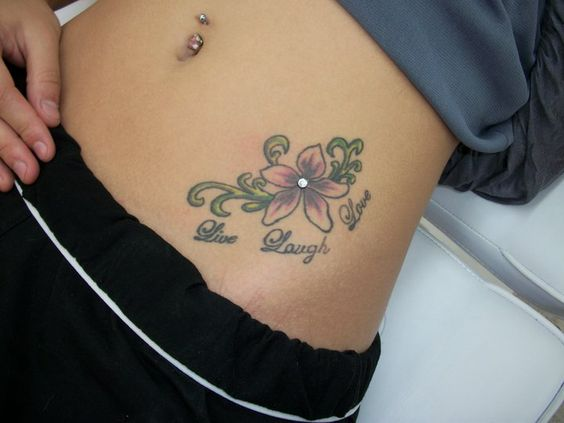 I think its very creative to incorporate a dermal piercing with a tattoo. So cute.