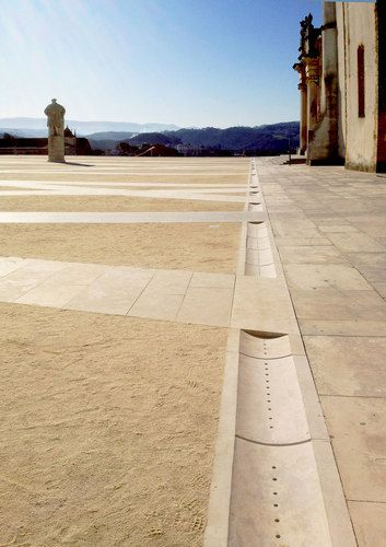 Drainage in the plaza in the Upper City of Coimbra, Portugal as redesigned by Gonçalo Byrne and BB Arquitectos. Click image for fully-illustrated profile and visit the slowottawa.ca boards http://www.pinterest.com/slowottawa/
