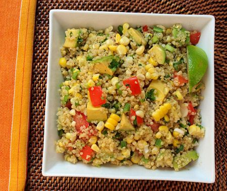 Quinoa salad with corn, tomato, avocado, and lime