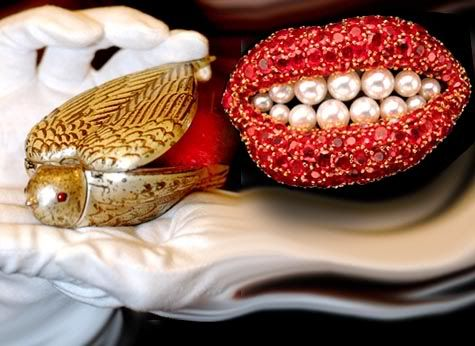 """Bird in Hand"", a gold- and silver-plated copper compact for lipstick and face powder, made in 1952, sold for about $25,000 in 2004; and the ""Ruby Lips"" brooch from 1949."