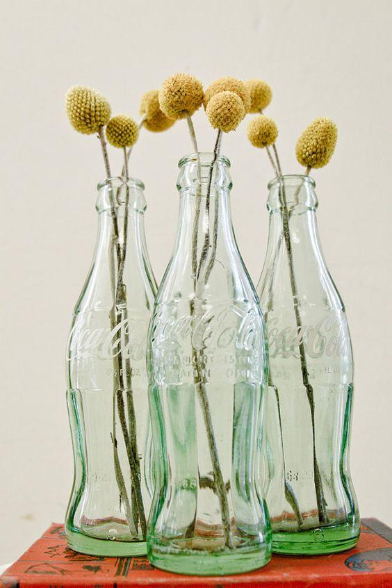 Vintage Coke Bottles. Perfect for a unique floral display. #vintage #cokebottle #vase