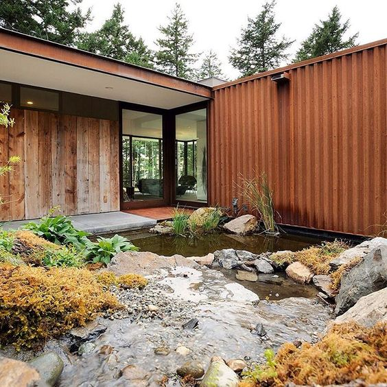 Rusty corrugated steel and wood salvaged from an old barn clad the exterior of this L-shaped house designed by American architect Gary Gladwish on Orcas Island, Washington. dezeen.com/tag/washington Photography is by Will Austin.