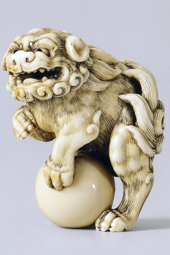 Netsuke Shishi with a Ball by Okatori in Antique Ivory. For Auction on 6 Dec 2014 with an estimate of euro 7000-9000. What a little beauty at 4.5cm high!!