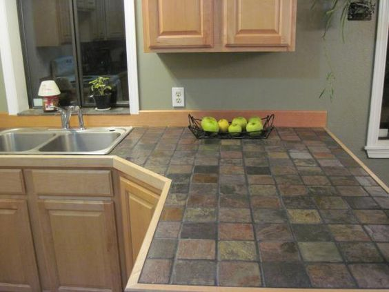 slate tile kitchen countertops. It could totally happen. I love the richness and variegated colors.