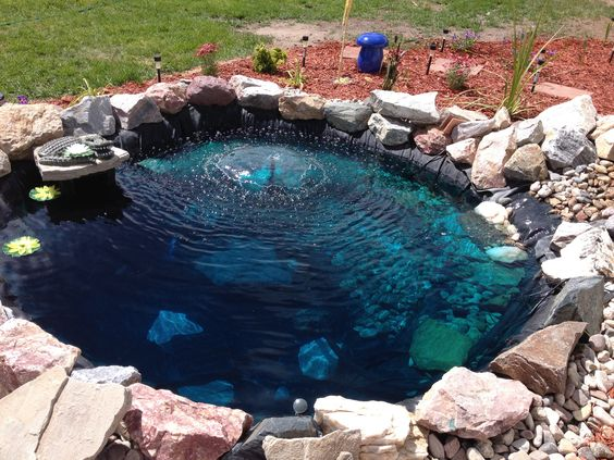 Dyes ponds and blue on pinterest for Blue koi pond liner