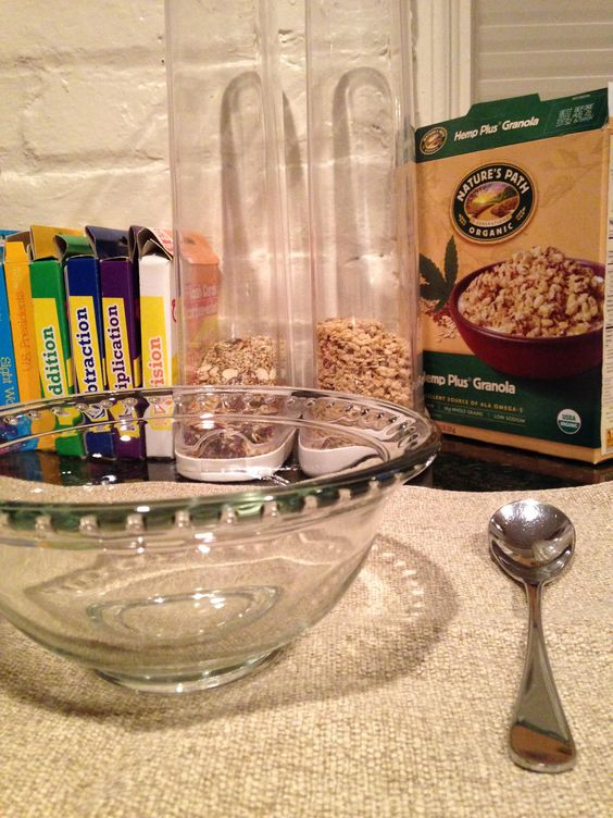 I always have canisters of healthy cereal on the breakfast bar and leave out bowls and spoons the night before.  The kids help themselves in the morning to get their breakfast started so that I can finish my sleep/shower/prep knowing that they are being fed. They feel empowered and I can concentrate on the 20 other things that need to be done each morning and we usually make it to school on time.  Oh yes, those ARE flash cards next to the cereal...