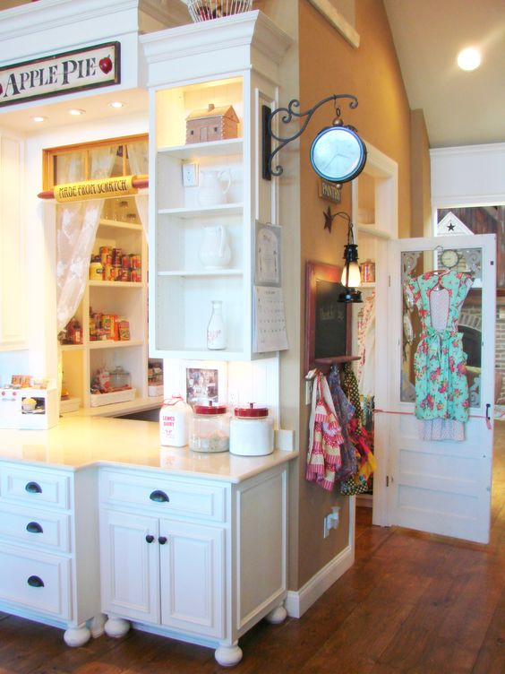 LOVE THIS SO MUCH! Pantry is a little room, has a cute door AND a window! Genius and Too Cute!