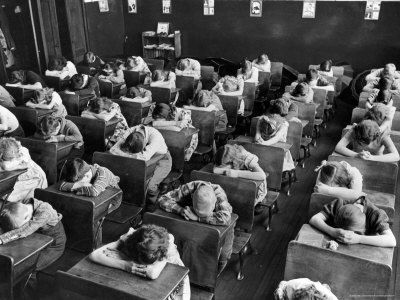 """Remember having to lay our heads down on our desks and rest?  When you think about it now, it was just so funny!--""""rest period""""--usually after lunch"""