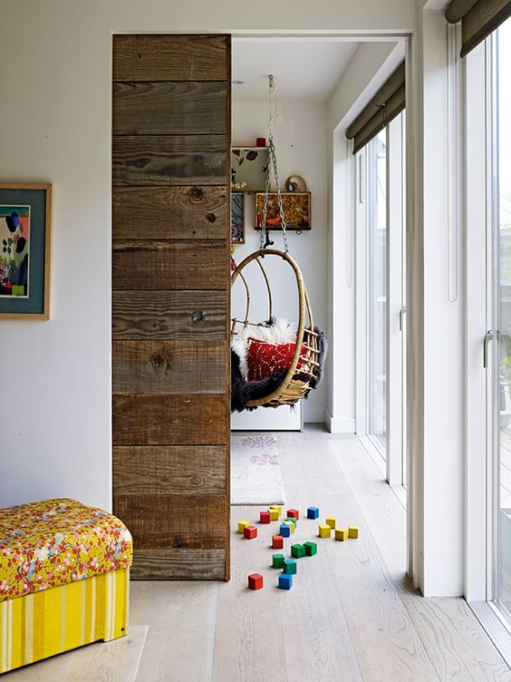 This pocket door system in Oliver Heath's home creates an open-plan feel between two spaces. The eco-interior designer bought the door system hardware and rails from Eclisse and made his own door using a substructure of 18mm MDF clad with reclaimed timber for a warmer effect.  Photo courtesy of: Real Homes magazine