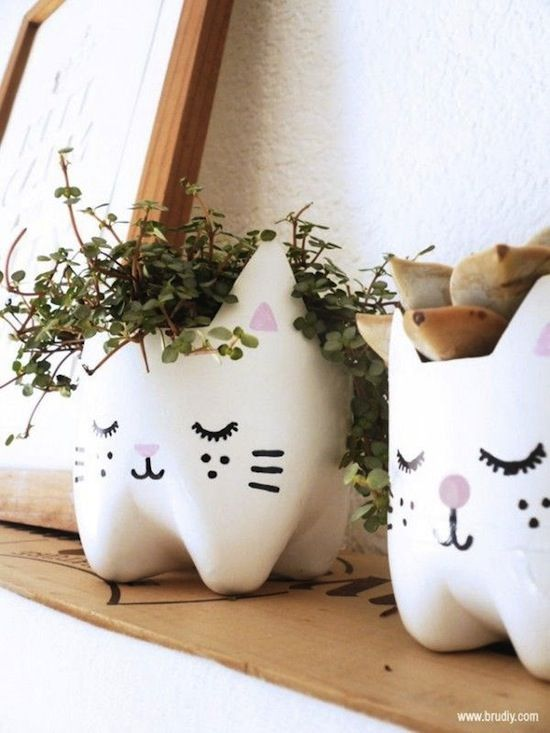 Cat Planter Pot.  DIY project made from an upcycled 2 liter soda bottle.  This idea could be adapted for a menagerie of planters.