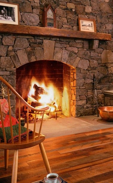 Floor level stone fireplace wooden mantle fireplaces for Cabin fireplace pictures