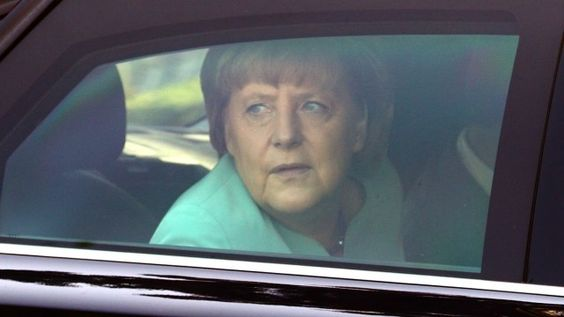 Germany's Chancellor Merkel looks through the window of her limousine as she arrives for a European People's Party EPP leaders' meeting in Vienna