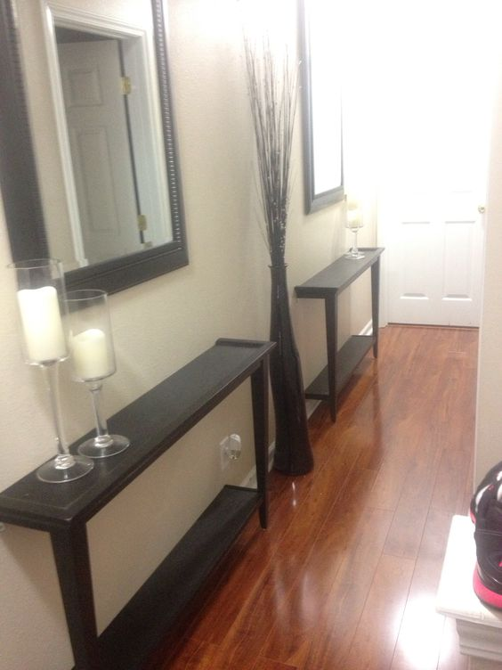 Narrow hallway decor solution! Cut a table in half and bolt to the wall!! Use mirrors to give it a larger space feel!