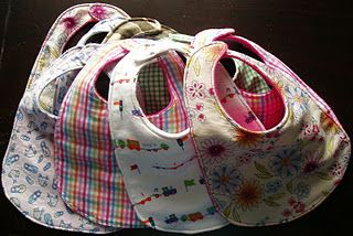These are the best directions for making bibs that I found.  It also has a link to a free pattern that I printed.