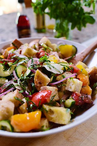 Panzanella..tomatoes, cucumber, red onion, bread cubes, basil ...