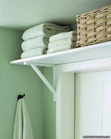 Get clever with your storage solutions. Placing a shelf above the door frame is a great space-saver for small bathrooms