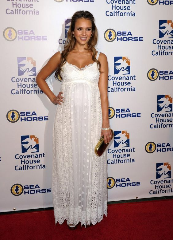 A pregnant Jessica Alba looking amazing in an all-white maxi dress.