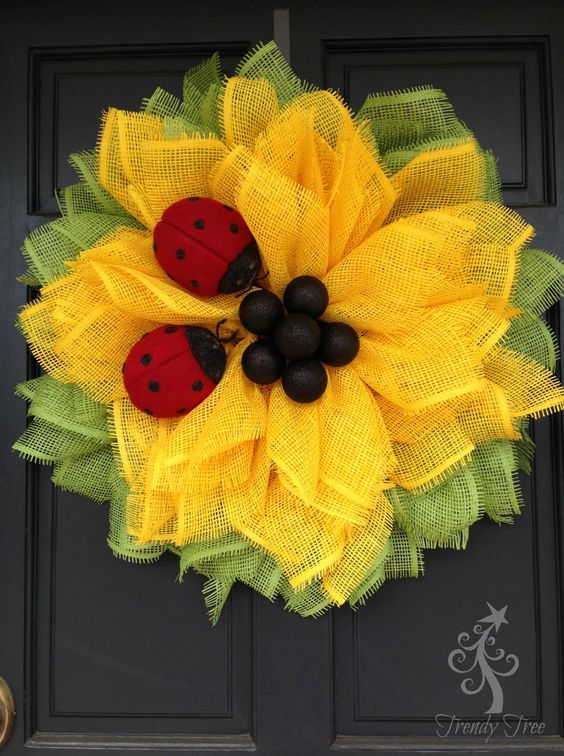 Here's our new 2016 version of the Sunflower wreath, we added ladybugs and more leaf petals to this wreath. It's an easy wreath to make. It's made out of paper mesh, and paper mesh is …made of paper. This paper mesh does have a special coating sprayed on it, but it's still paper. It should …: