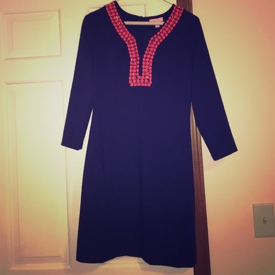 Lilly Pulitzer Bennett Shift NWT size 2 navy/coral beading Bennett Shift. Retails $288. Adorable fall/winter dress! Decided it was a bit too snug on me so I never wore it. Appears to have a small blemish on front (pic 4) but is new from the Lilly site and never worn. Love this dress but sad I couldn't wear it. Would love to give it to another lover of Lilly! No trades. Offers accepted. Lilly Pulitzer Dresses Long Sleeve