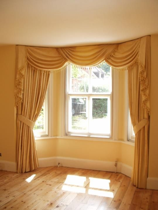 Bay Window Swags And Tails Living Room Drapes Large Living Room Layout Bay Window Dressing