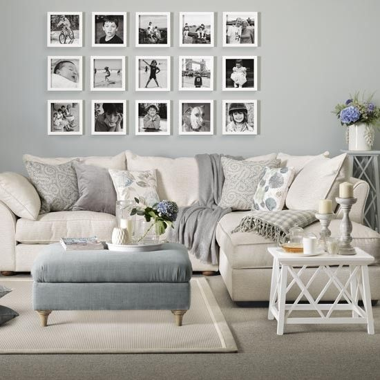 Family living room with picture gallery. Personalise your living room with an arrangement of favourite family photographs. A bare expanse of wall above the sofa or a sideboard makes the ideal spot. Choose frames that are identical in size and colour, and arrange in a grid formation to make a visual impact. Corner chaise sofa, Collins & Hayes, Box frames, Bombus.