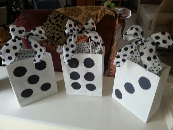 Prizes for Bunco. Simply bought white bags, and glued dots on them.