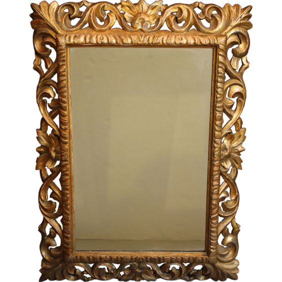 Gilt Scrollwork Mirror   Over fireplace or on perpendicular wall (landscape)