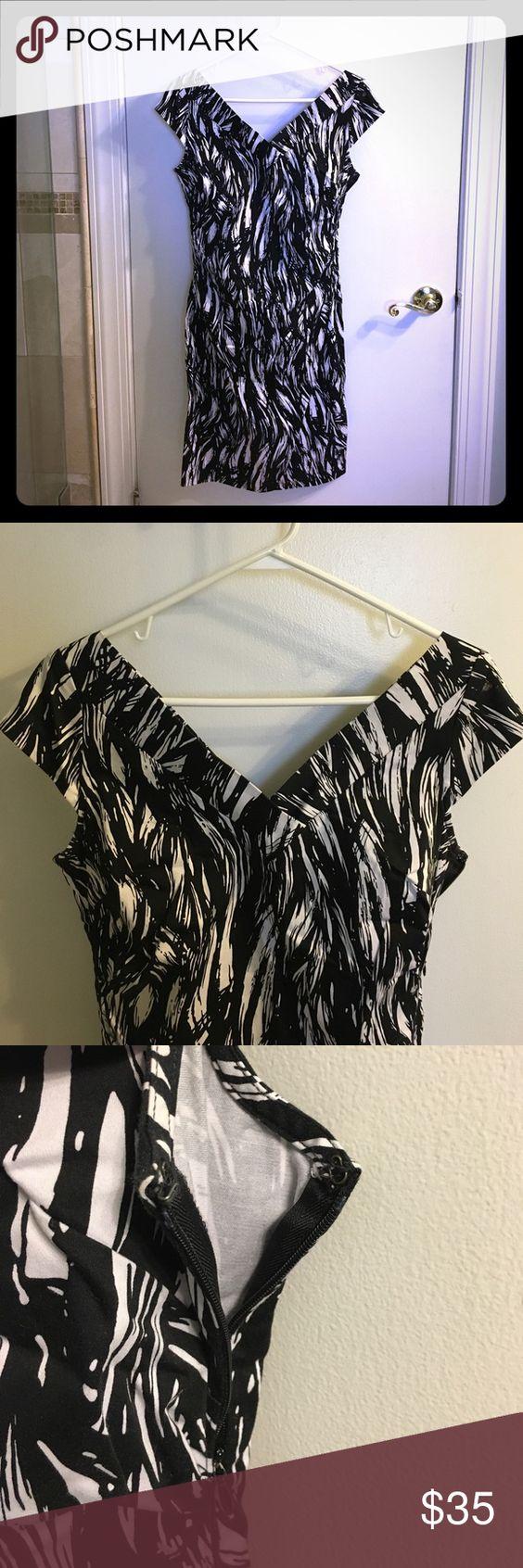 Black and white New York & Co. dress Fitted black and white cotton blend New York & Co. dress, with wide v-neck detail and slit at back bottom. Hem hits around knees. New York & Company Dresses Midi