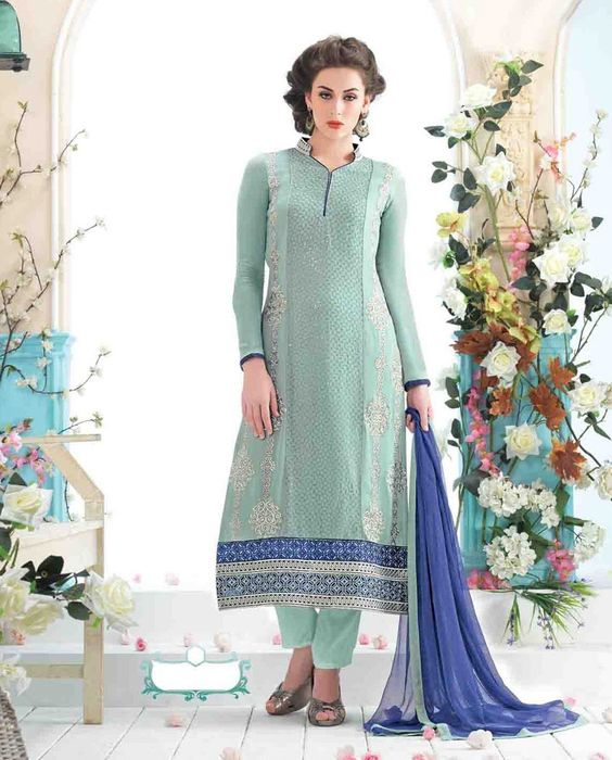 Pista green long suit with embellished hemline   1. Pista green georgette long suit2. Comes with matching bottom and  dupatta3. Can be stitched up to bust size 42 inches