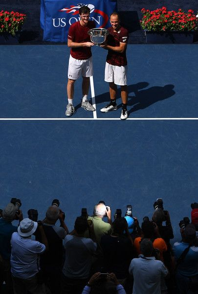 (L-R) Jamie Murray of Great Britain and Bruno Soares of Brazil celebrate with the trophy after defeating Pablo Carreno Busta and Guillermo Garcia-Lopez of Spain with a score of 6-2, 6-3 in their Men's Doubles Final Match on Day Thirteen of the 2016 US Open at the USTA Billie Jean King National Tennis Center on September 10, 2016 in the Flushing neighborhood of the Queens borough of New York City.
