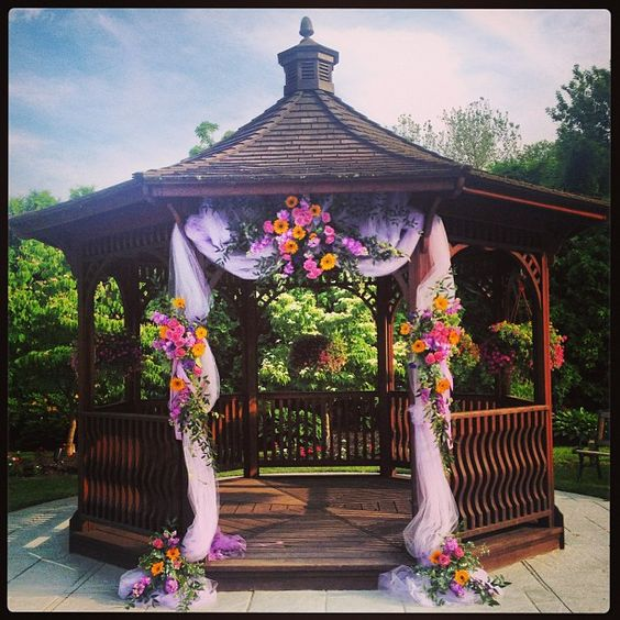 Floral arrangements fall flowers and wedding on pinterest for Outdoor wedding gazebo decorating ideas