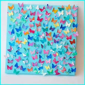 I want to have the girls paint on watercolor paper, then I'll cut out tiny butterflies and sew them to a canvas.  I like how the wings peek over the edges.