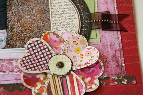 The Blogger says:  I made the flower by cutting out some hearts from the BG patterned paper.  I layered lots of papers and machine stitched around their edges.