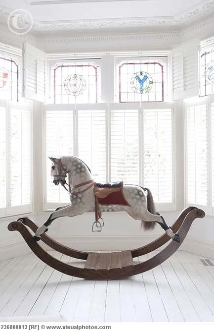 Rocking horse.. I would LoVe to find one like this for the girls :)