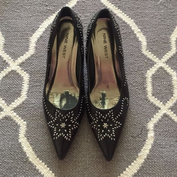 Nine West leather pointy kitten heel with metal Black leather with silver leather embellishment, soles were replaced and they have a cute lower heel Nine West Shoes