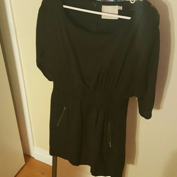 Little black dress! Great condition Worn a few times 3/4 sleeves with zippers 2 zipper pockets on the front and zipper down the middle on the back Lush Dresses