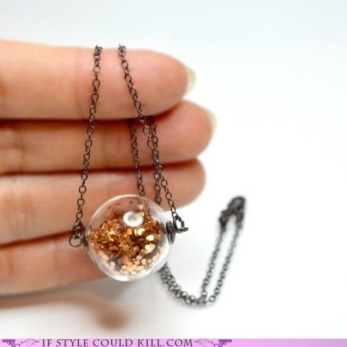 lil orb of sparkles--so sweet! I wonder if I could make somethin similar on my own, maybe using a glass vile of sorts with a cork in it.