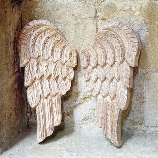 Carved Angel Wings This beautiful and exclusive pair of hand-carved wooden wings look heavenly on any wall. Would look wonderful above a child's bed and equally stunning on a plain plaster wall. Limed wood, carving may vary. £35: