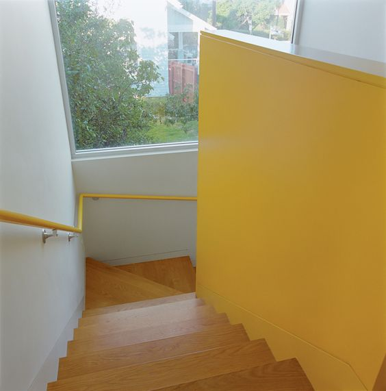 Bestor gave each area of the house its own color scheme. The bright yellow stairwell maintains a cheery mood throughout.  Photo by: Ye Rin Mok      Read more: http://www.dwell.com/slideshows/surfers-turf.html?slide=7=y=true#ixzz1tvKUKNY1