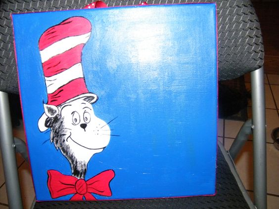 The Cat in the Hat is back and better than ever.... this canvas is ready to be completed with white letter of some teacher and then hung on her door.