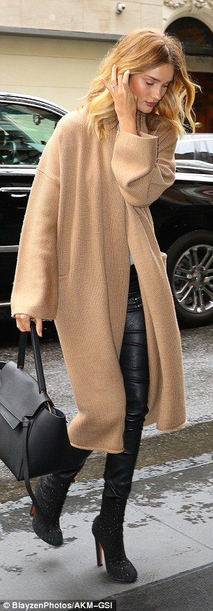 Putting her best foot forward: Adding some extra height to her look, she wore a pair of sky-high ankle boots