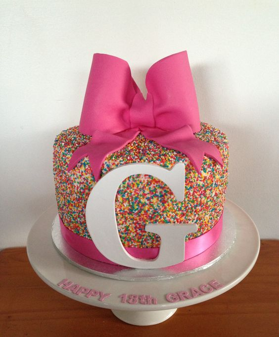 Pink 18th birthday cake with sprinkles a large pink bow for 18th cake decoration