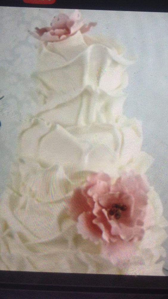 Shelley Haugeto I thought of you when I saw this cake! Navy blue would beautifully accent the soft petal look :)