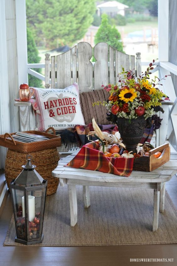 Fall arrangement with apples, mums and sunflowers on the porch | ©homeiswheretheboatis.net #fall #flowers #sunflowers #apples #FloralFriday