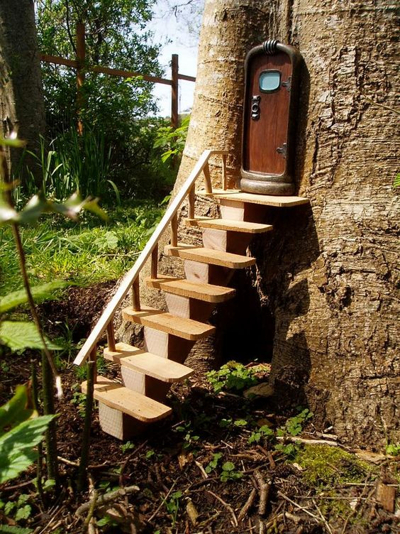 Fairy door (from Home & Garden Art in Seattle, WA) with stairs (built and installed by Allan Fritz), photographed by Skyler Walker of Tangly Cottage Gardening. (© 2012)    I thought fairies had wings?  Do they need stairs?